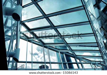 hi tech building - glass and metal blue tones - stock photo