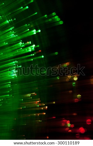 hi-tech concept - defocused illumination from fiber optic glass - stock photo
