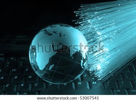 hi-tech earth globe against fiber optic background - stock photo