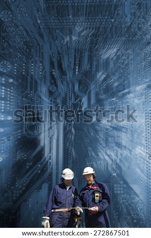 hi-tech engineering with computers circuit--board as background, slight zoom effect. - stock photo