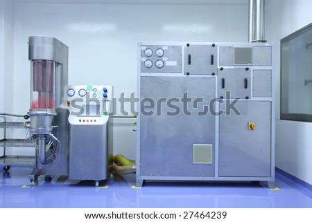 Hi-tech equipment of pharmaceutical factory - stock photo