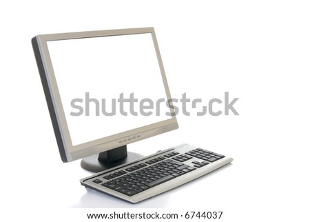 Hi Tech slim line Computer screen and keyboard  on reflective surface.  White background