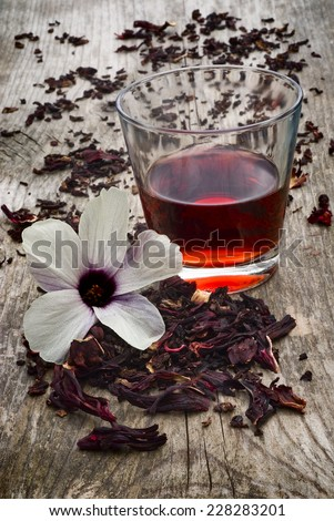 Hibiscus tea (Hibiscus sabdariffa) also known as Karkad���¨ or Roselle. Flower and sepals dried for infusions - stock photo