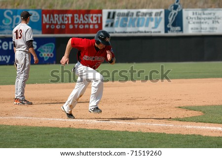 HICKORY, NC USA - MAY 31 : Mike Hollander(17) of the Hickory Crawdads, class A affiliate of the Texas Rangers,  heads home in a game in Hickory NC at LP Frans Stadium, May 31, 2009