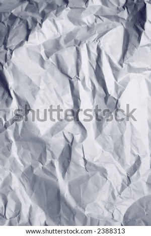 Hidden face in wrinkled wrapping paper