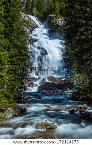 Hidden Falls near Jenny Lake in Grand Teton National Park, WY - stock photo
