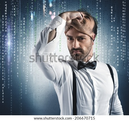 Hidden identity of a hacker under the mask - stock photo