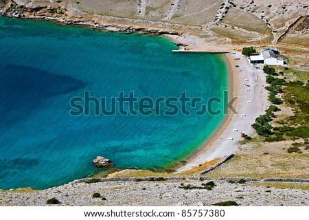 Hidden pebbles and sand beach in Vela Luka, Island pf Krk, Croatia - stock photo