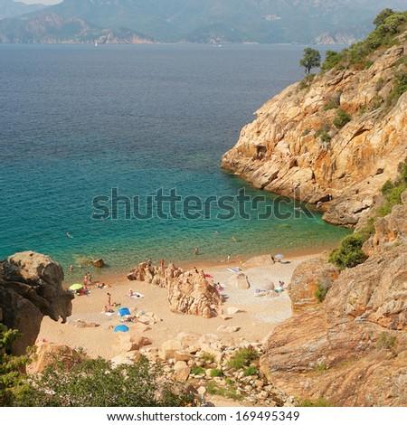 Hidden Rocky beach by Ficajola, Corsica - stock photo