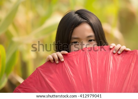 Hide behind the umbrella