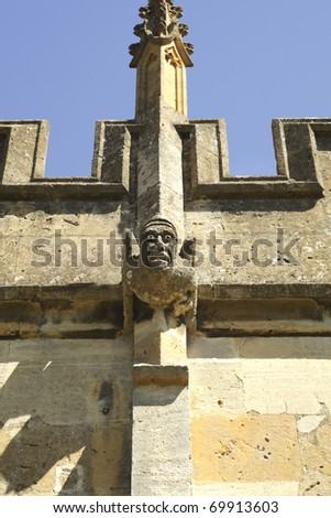Hideous gargoyle at st. Peters church in Winchcombe - stock photo
