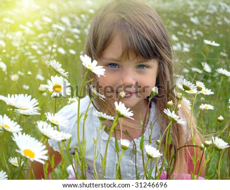 Hiding behind the flowers - stock photo