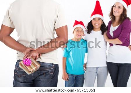 hiding Christmas gift - stock photo