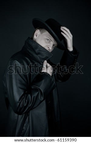 Hiding mafiosi in black coat