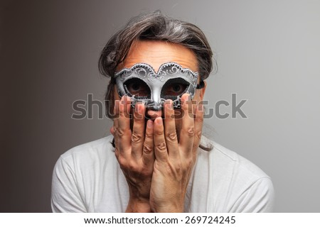 hiding man at the masquerade with silver mask - stock photo