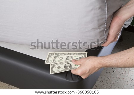 hiding money under the mattress better than banks? - stock photo