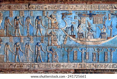 Hieroglyphic carvings and paintings on the interior walls of an ancient egyptian temple in Dendera - stock photo