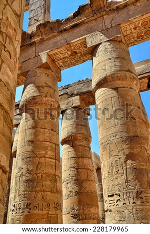 Hieroglyphic covered columns in the Hypostyle Hall. Karnak Temple, Luxor, Egypt