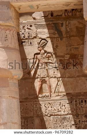 Hieroglyphic writing under the sunlight - stock photo