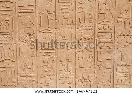 Hieroglyphs on a wall in Karnak Temple. Luxor, Egypt - stock photo