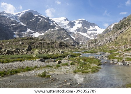 High Alps in the Bernese Oberland in Switzerland with creek - stock photo