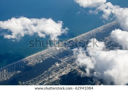 High altitude photo of inter-coastal city and ocean - stock photo