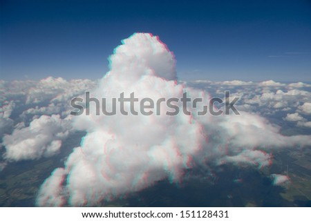High altitude view of a cumulus cloud in 3D. View anaglyph with red/cyan glasses. - stock photo