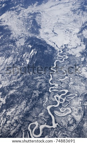 High altitude view of a frozen river in Arctic Canada.. - stock photo