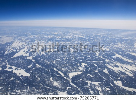 High altitude view of the frozen tundra in Arctic Canada - stock photo