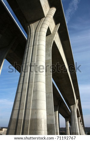high and long concrete bridge across the valley - stock photo