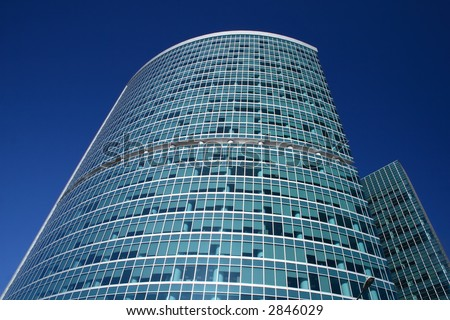 High and modern office building over deep blue sky - stock photo