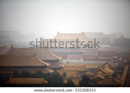 High angle horizontal shot of the Forbidden City in Beijing,  China, on a foggy day. - stock photo