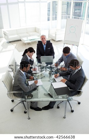 High angle of a business people showing diversity in a meeting - stock photo