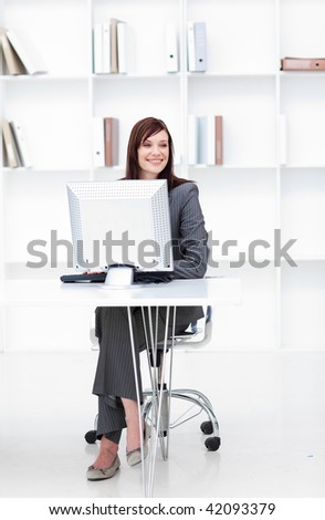 High angle of a young businesswoman working at a computer in the office - stock photo
