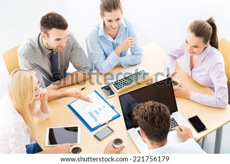 High angle of business people at table - stock photo