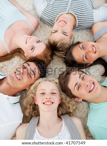 High angle of friends with their heads together smiling - stock photo