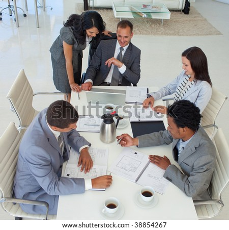 High angle of international business people working in a meeting - stock photo
