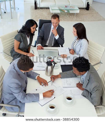 High angle of international businessteam working in a meeting - stock photo
