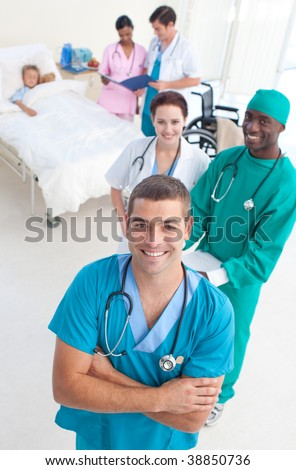 High angle of medical team attending to a young patient in bed - stock photo
