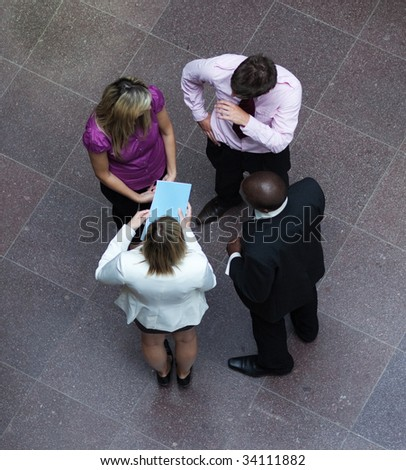 High angle of multi-ethnic business people talking in office - stock photo
