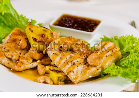High Angle of Pineapple Cashew Chicken Dish on Plate in Restaurant - stock photo