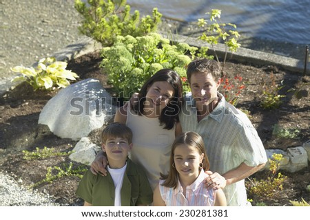 High angle portrait of a family posing for the camera - stock photo