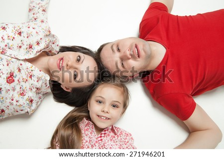 High angle portrait of happy family lying on white background