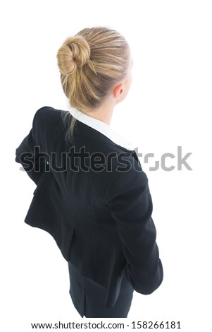 High angle rear view of attractive blonde businesswoman posing on white background