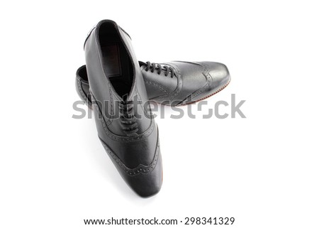 High angle shot of a pair of formal shoes, isolated on white background - stock photo