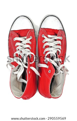 high-angle shot of a pair of red sneaker boots with white shoelaces on a white background