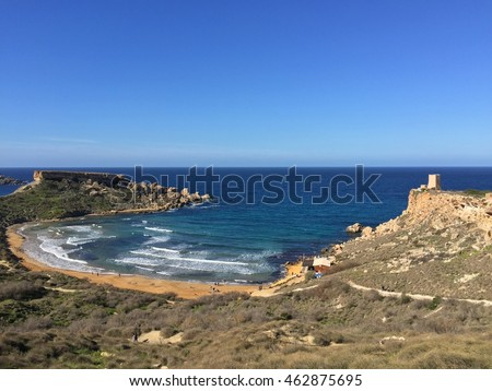 High angle shot of sandy beach and bay in the Mediterranean on a sunny cloudless day in spring