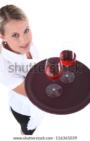 high angle shot of young waitress - stock photo