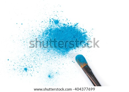 High Angle Still Life of Make-Up Brush Applicator with Bright Blue Eyeshadow Cosmetic Powder Scattered on White Background with Copy Space - stock photo
