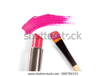High Angle Still Life of Tube of Pink Lipstick with Applicator Brush and Smudge of Pink Make Up Across White Background with Copy Space - stock photo